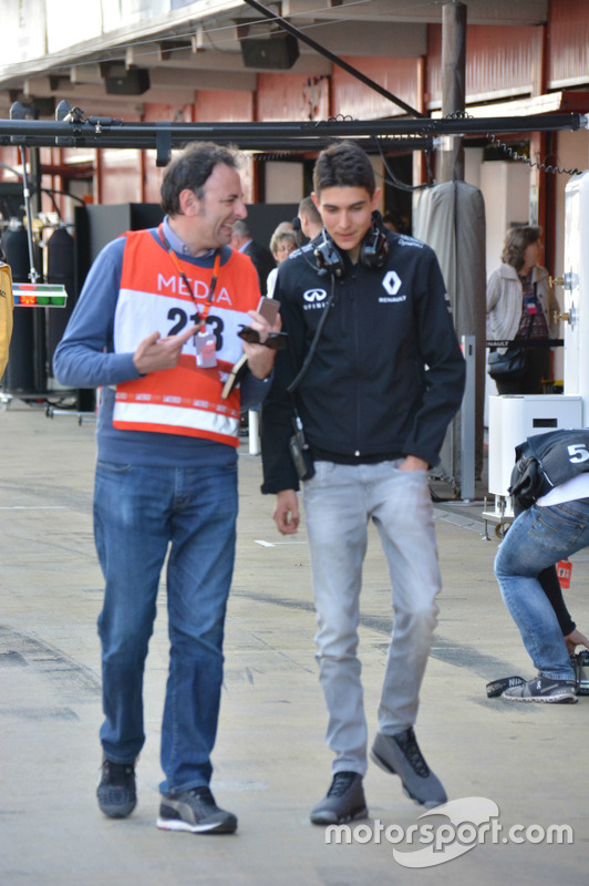 Esteban Ocon with Roberto Chichero in the pitlane in Barcelona